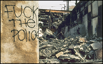 """Fuck the Police"" graffiti in rubble"